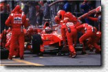 Michael Schumacher managed to get out of the pits right in front of his rivals Wurz and Frentzen, although he had stalled the engine during the pitstop.