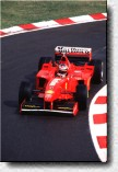 Michael Schumacher on his way to victory with the F300 s/n 184