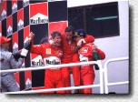 Michael Schumacher, Jean Todt and Eddie Irvine on the podium. Does this picture need more words?