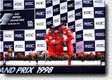 A happy Jean Todt with his drivers Schumacher and Irvine