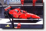 Michael Schumacher comes into the pits with his damaged F300 s/n 188