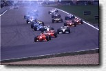 Seconds after the start: Eddie Irvine (F300 s/n 184) leads in front of Schumacher (F300 s/n 189)