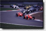 The grid in the Castrol S, the first corner after the start - Eddie Irvine (F300 s/n 184) leads in front of Schumacher (F300 s/n 189)