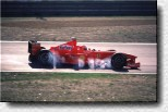 Michael Schumacher and a smoking F300 s/n 189