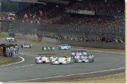 Start at Le Mans: Laurent Aiello (#2) in the Infineon Audi R8 is ahead of Frank Biela (#1)