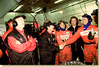 Happy birthday: Audi driver Rinaldo Capello celebrates his 37th birthday at midnight in the Audi pits