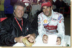 Racing legend Mario Andretti (left) with Audi driver Emanuele Pirro (right) at the 2001 Le Mans 24 Hour race
