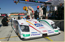 Frank Biela gives the #2 ADT Champion Audi R8 to Emanuele Pirro