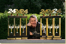 Tom Kristensen with his Le Mans trophies