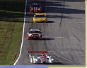 Audi R8 with Emanuele Pirro in his slip stream a BMW M3, a Chevy Corvette followed by a Dodge Viper